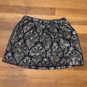 I am selling a skirt with gold patterns.